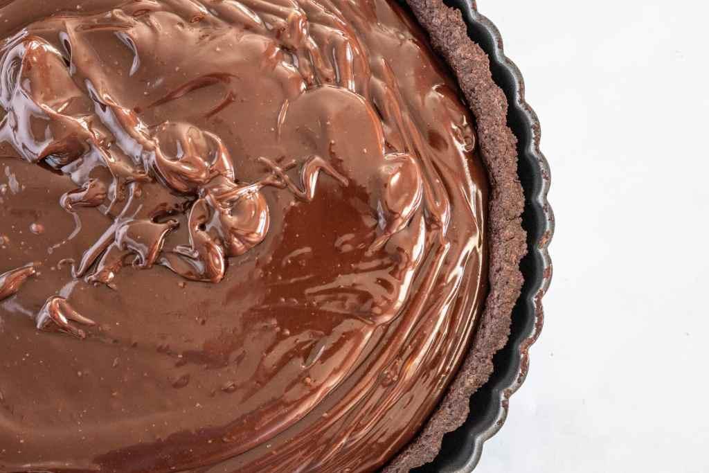 dark chocolate ganache filling in chocolate pate sucree crust.