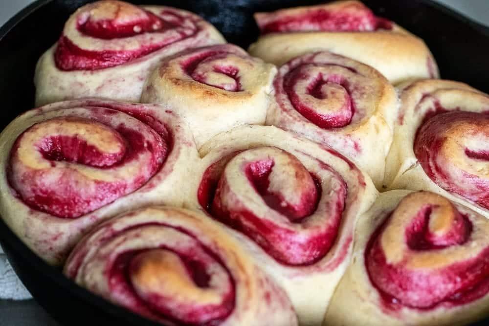 baked raspberry sweet rolls in cast iron skillet