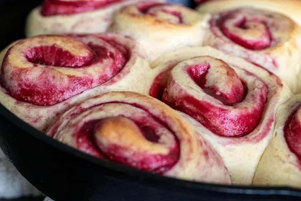 raspberry sweet rolls in lodge cast iron skillet