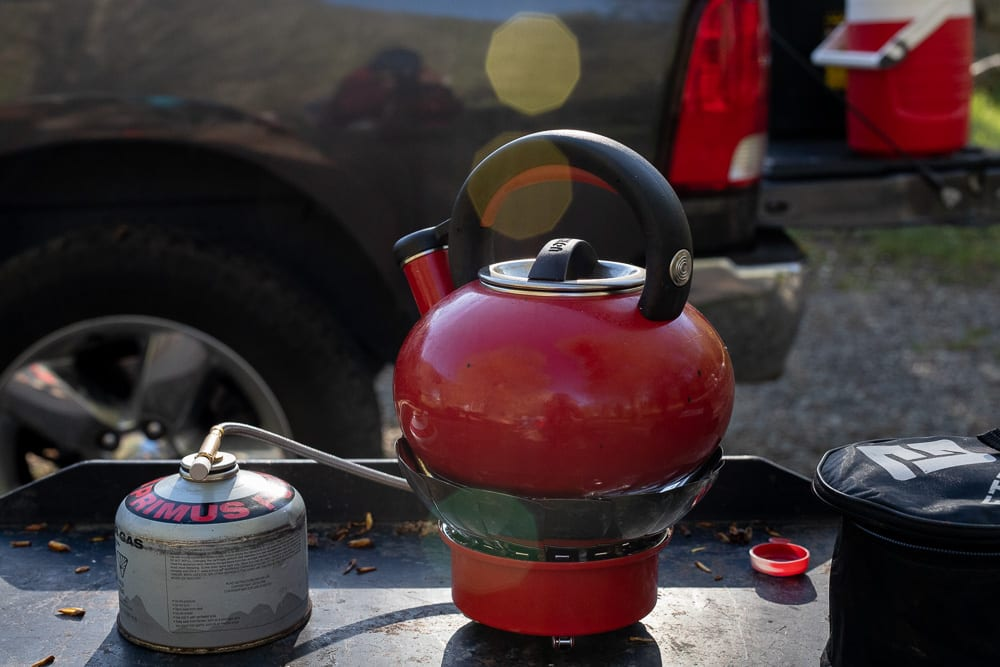 Tea pot over small backpacking stove