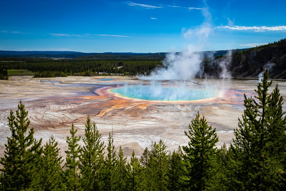 grand prismatic springs with steam rising off of it