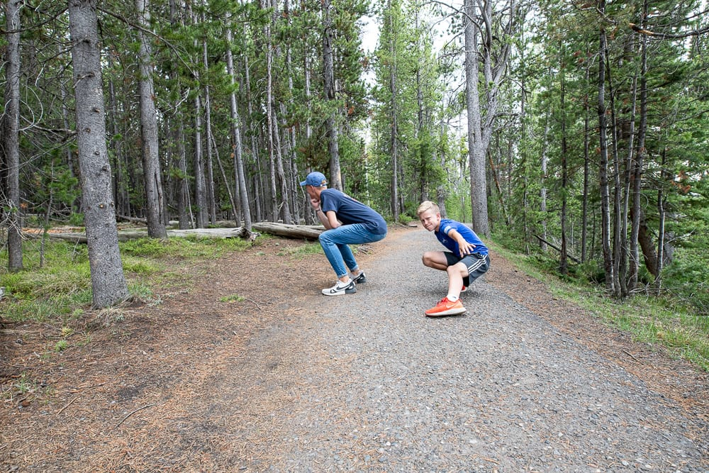 two boys having fun on a trail in yellowstone national park