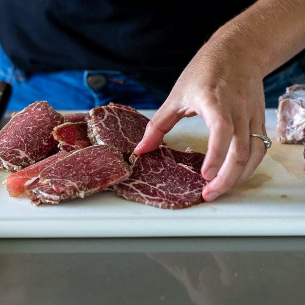 slices of beef tenderloin on white cutting board