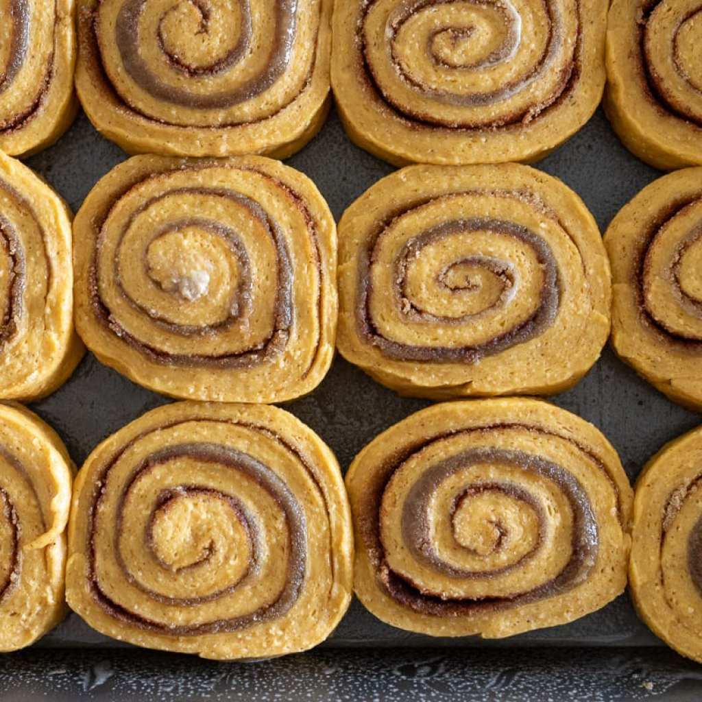 cinnamon rolls rising in a pan