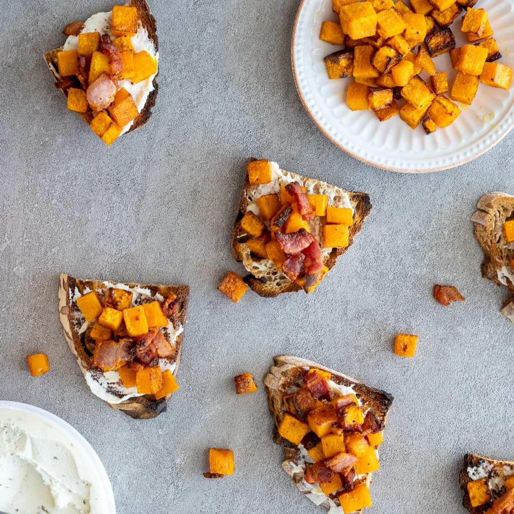 Roasted Butternut and Bacon Toast on surface with butternut