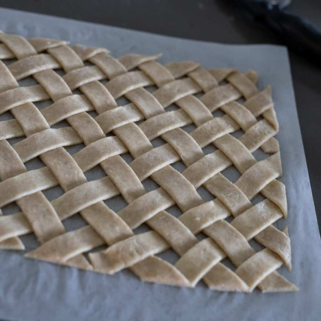 lattice pie top on parchment paper
