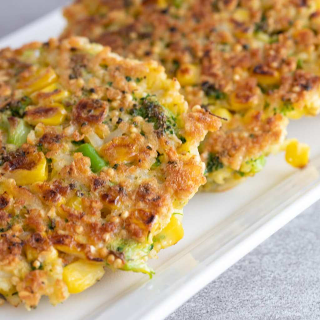 crispy vegetable fritters on a serving tray