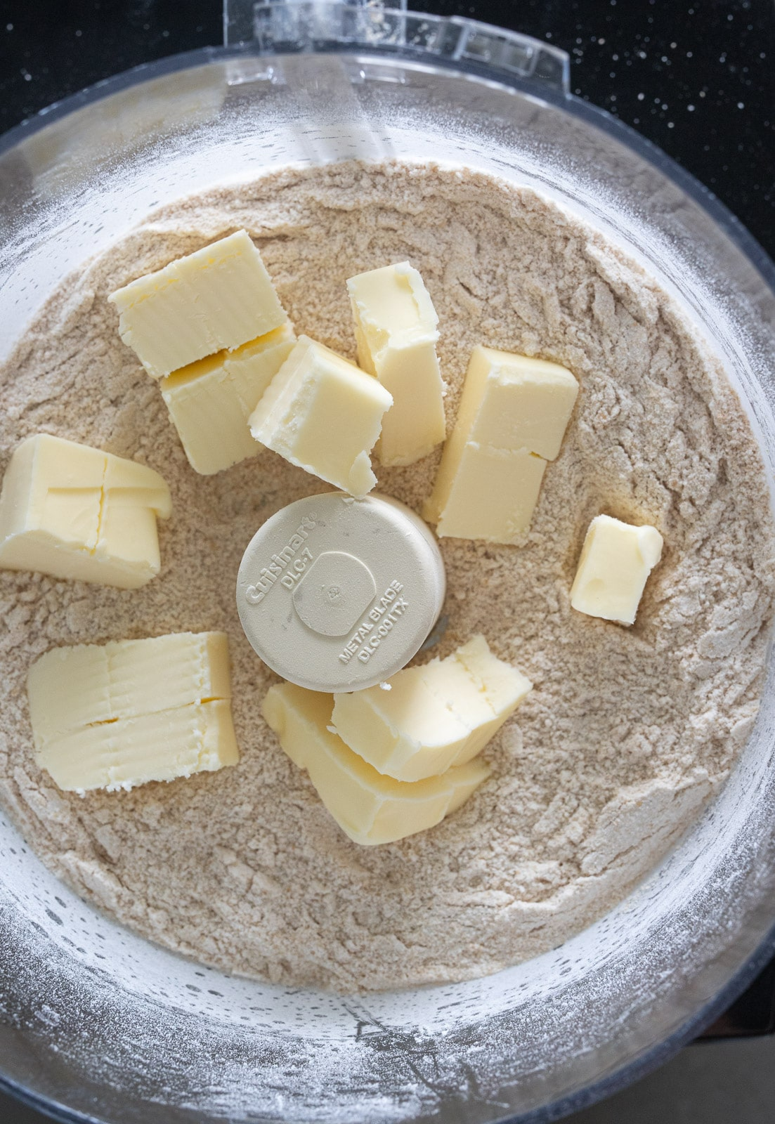 Butter in a food processor for making biscuits.