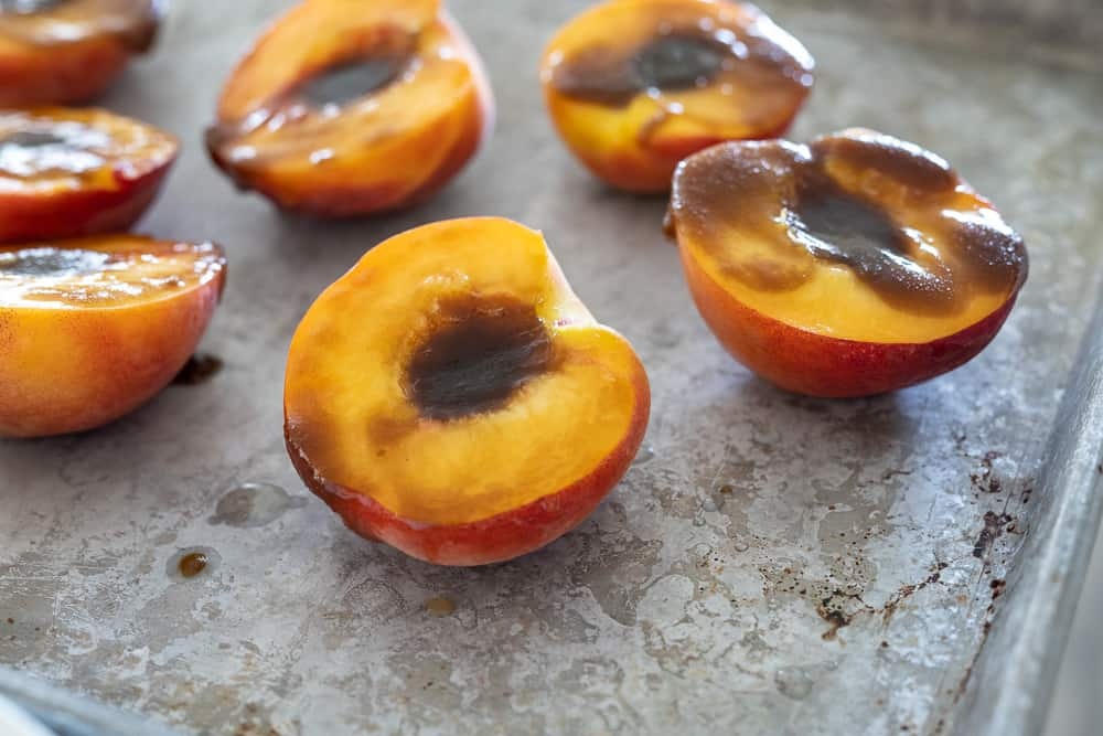 Peaches brushed with butter and brown sugar.