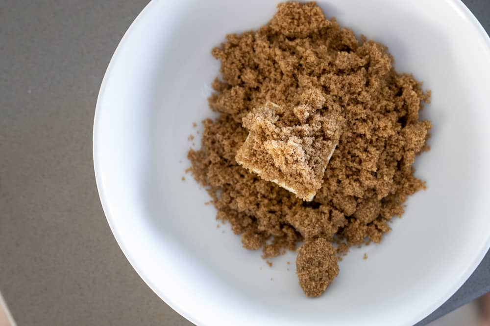 Butter and brown sugar in a bowl.