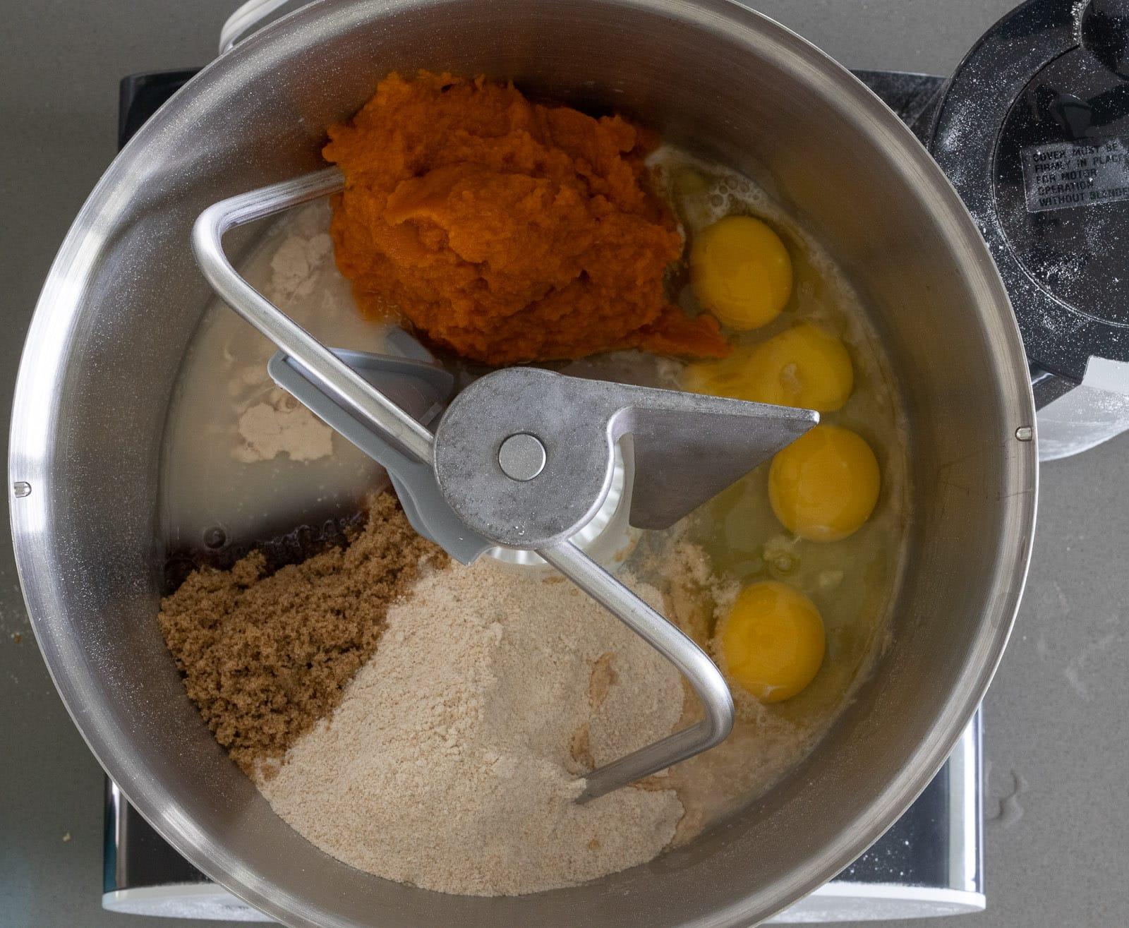 Ingredients for pumpkin brioche dough in a Bosch mixer.