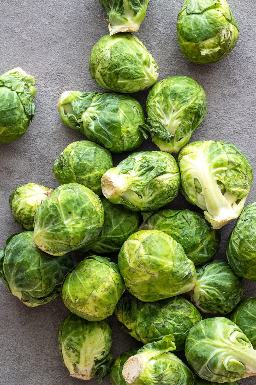raw brussel sprouts on a surface.