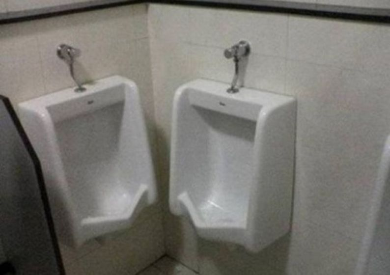 Urinal layout designed by an idiot.