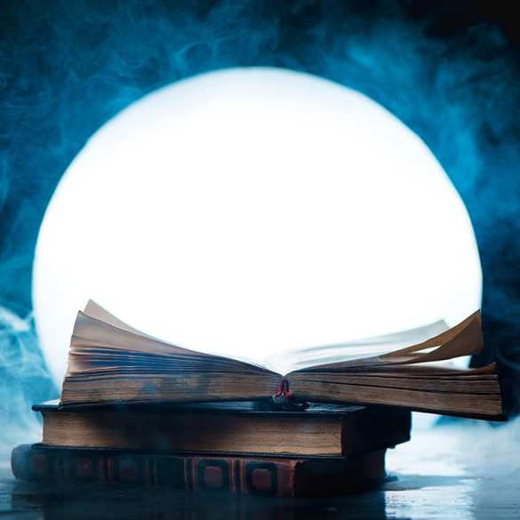 open book and full moon