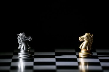 Chess knights facing each other