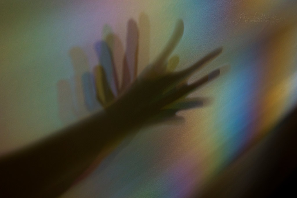 hands and prism