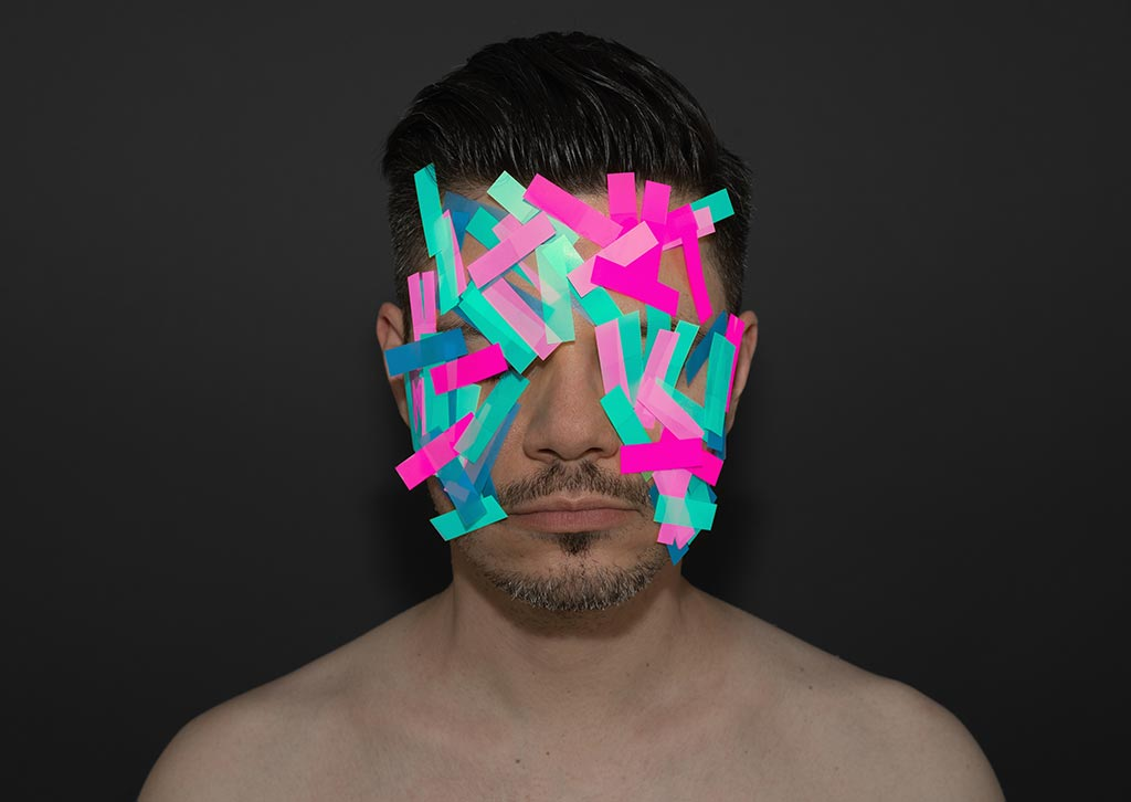 man with post it notes on face