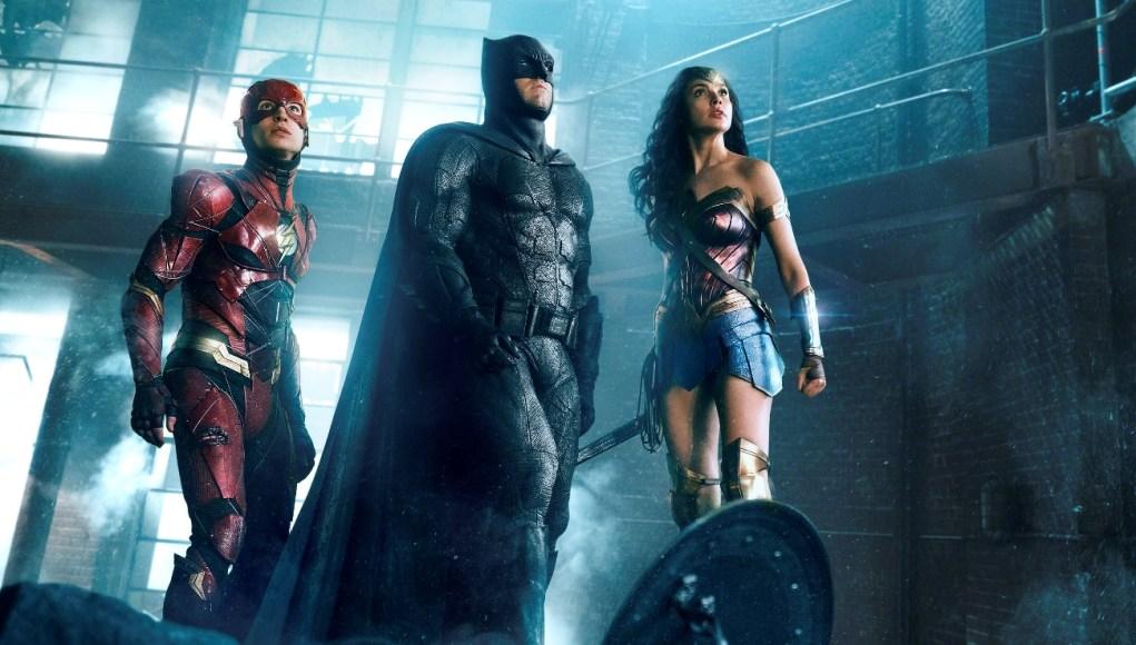 EZRA MILLER as The Flash, BEN AFFLECK as Batman and GAL GADOT as Wonder Woman in Warner Bros. Pictures' action adventure