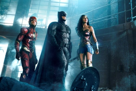 "EZRA MILLER as The Flash, BEN AFFLECK as Batman and GAL GADOT as Wonder Woman in Warner Bros. Pictures' action adventure ""JUSTICE LEAGUE,"" a Warner Bros. Pictures release."