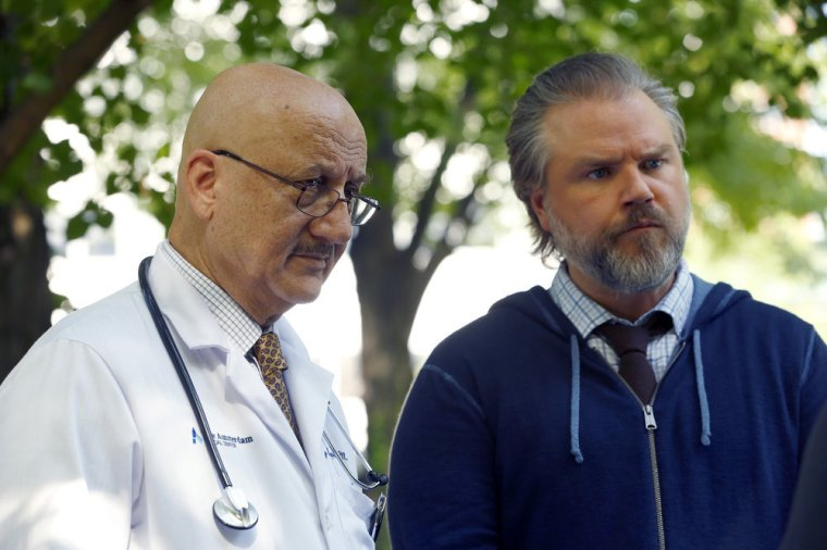 """NEW AMSTERDAM -- """"Rituals"""" Episode 102 -- Pictured: (l-r) Anupam Kher as Dr. Vijay Kapoor, Tyler Labine as Dr. Iggy Frome -- (Photo by: Will Hart/NBC)"""