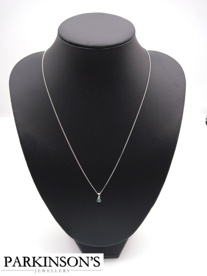 925 silver light blue cz birthstone pendant on jewellery stand