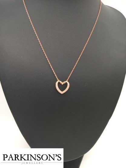 Rose gold on silver cz heart pendant on jewellery stand