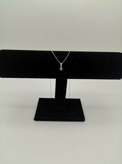925 silver white cz birthstone pendant on jewellery stand