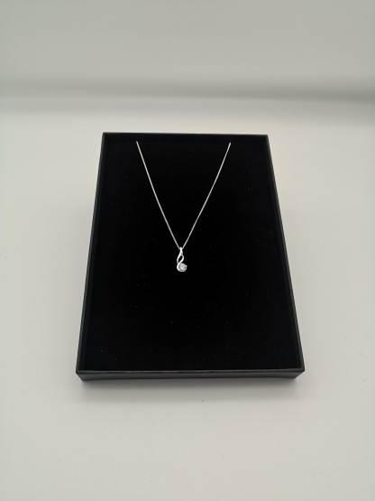 swirling sterling silver cz pendant in eco friendly jewellery case