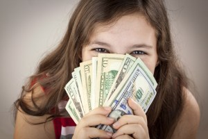 Beautiful teen girl holding money