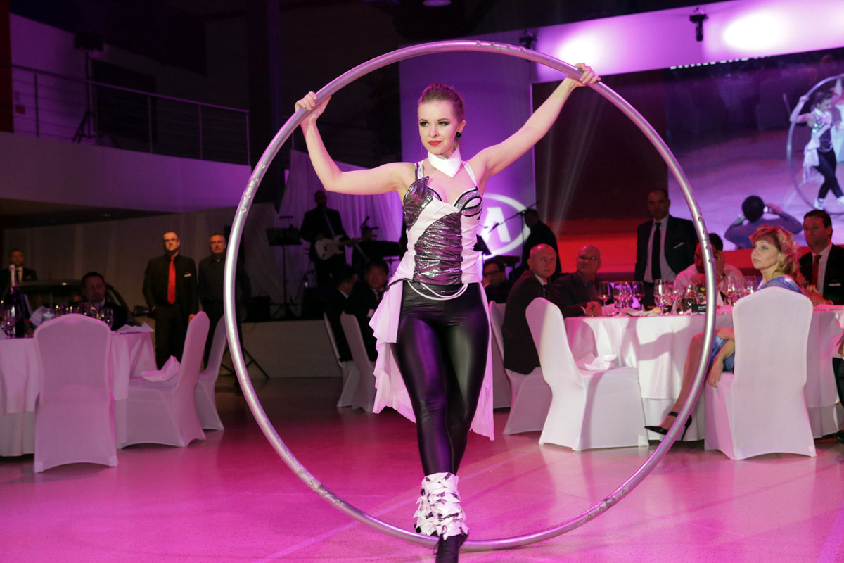 Woman Cyr Wheel artist - Argolla show - corporate event Kia