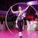 Woman Cyr Wheel artist - Argolla show - corporate event Kia