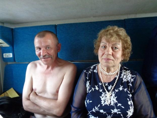 Fotografi av to russiske togreisende.