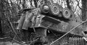 German PzKpfw VI Tiger tank overturned during the Allied heavy bombing at the beginning of Operation 'Goodwood', July 1944.