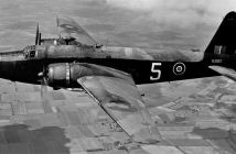 """""""Wellington Mk.IA (N2887) of the CGS (Central Gunnery School) based at Sutton Bridge flying south-east of Chatteris, 24th June, 1943. (Credits: GOV UK)"""