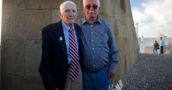 "James ""Pee Wee"" Martin, left, poses for a photo with Erich Bessoir June 7, 2014, at Omaha Beach, in Normandy, France. Martin met Bessoir, a German World War II veteran of the Waffen-SS, to promote understanding of former enemies and progressing international friendships during the celebration of the 70th Anniversary of D-Day. (Credits: Alexander W. Riedel)"