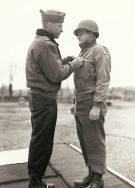 Brig.Gen. Charles D. Palmer receiving the Legion of Merit from Lt.Gen. Alexander M. Patch.