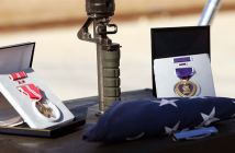 The American flag, crisply folded into a tight triangle, rested at the base of the rifle's barrel and was flanked by three of Ehle's most recent awards - Bronze Star on the left - Purple Heart on the right -Combat Infantryman's Badge on the bottom. U.S. soldiers held a memorial service near Hit, Iraq April 7, 2006, to honor one of their fallen. Ehle, a 19-year-old from Alexandria, Va., died April 2, 2006, as a result of a wound received during combat operations on March 28, 2006 in Hit. (Credits: U.S. Military)
