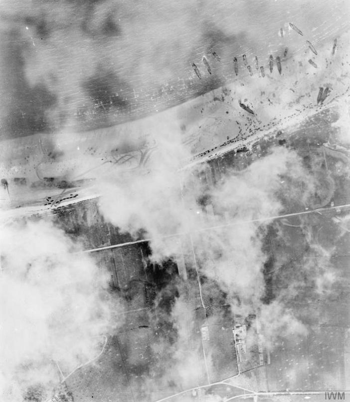Aerial photo of the landings on sector Mike, Juno Beach assault area, to the west of Courselles-sur-Mer, 6 June 1944. (Credits: CL 41 / Imperial War Museum)