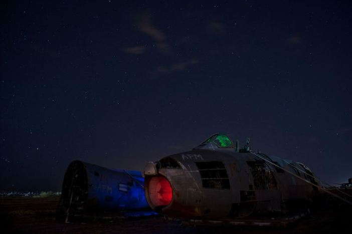 "A North American F-86 Sabre sits in pieces under the night sky at the ""boneyard"" of Davis-Monthan Air Force Base, Ariz. The Sabre was a transonic jet fighter aircraft mainly used during the Korean War and the early parts of the Cold War era. (Credits: U.S. Air Force photo/Senior Airman Andrew Lee)"