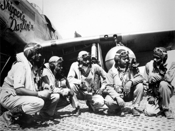 Pilots of the 332nd Fighter Group at Ramitelli Airfield, Italy; from left to right, Lt. Dempsey W. Morgan, Lt. Carroll S. Woods, Lt. Robert H. Nelron, Jr., Captain Andrew D. Turner, and Lt. Clarence P. Lester