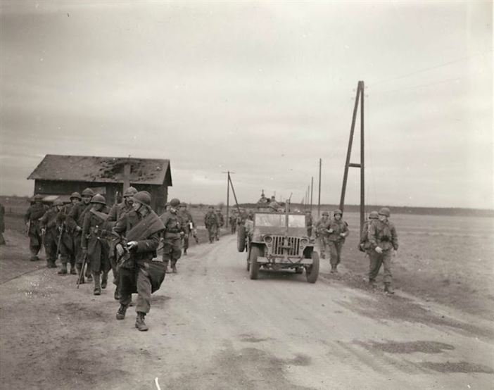 Infantrymen meet a patrol of the French Army on a fork of the road leading into (?), Germany. The (?) came down from the east side of the Rhine to help the French army in their Rhine river crossing and this is the first meeting of the two armies.
