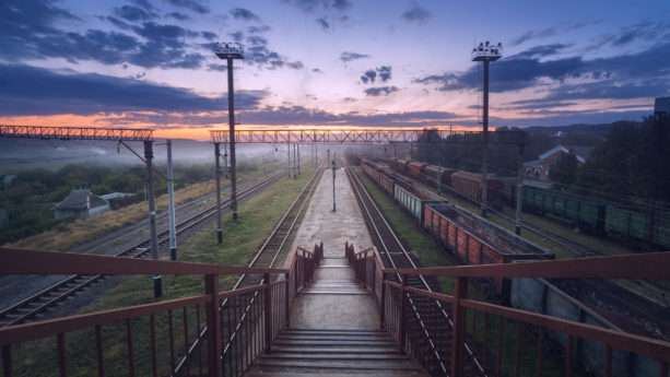 Cargo train platform at sunset. Railroad in Ukraine. Railway station.