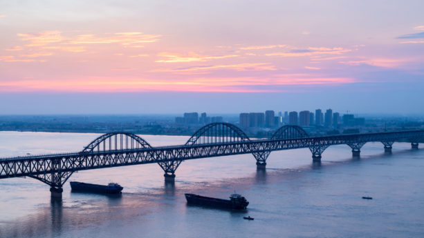 jiujiang yangtze river bridge with sunset glow, China