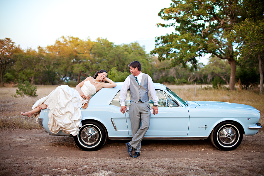 Bride and Groom with old blue mustang at Memory Lane Event Center
