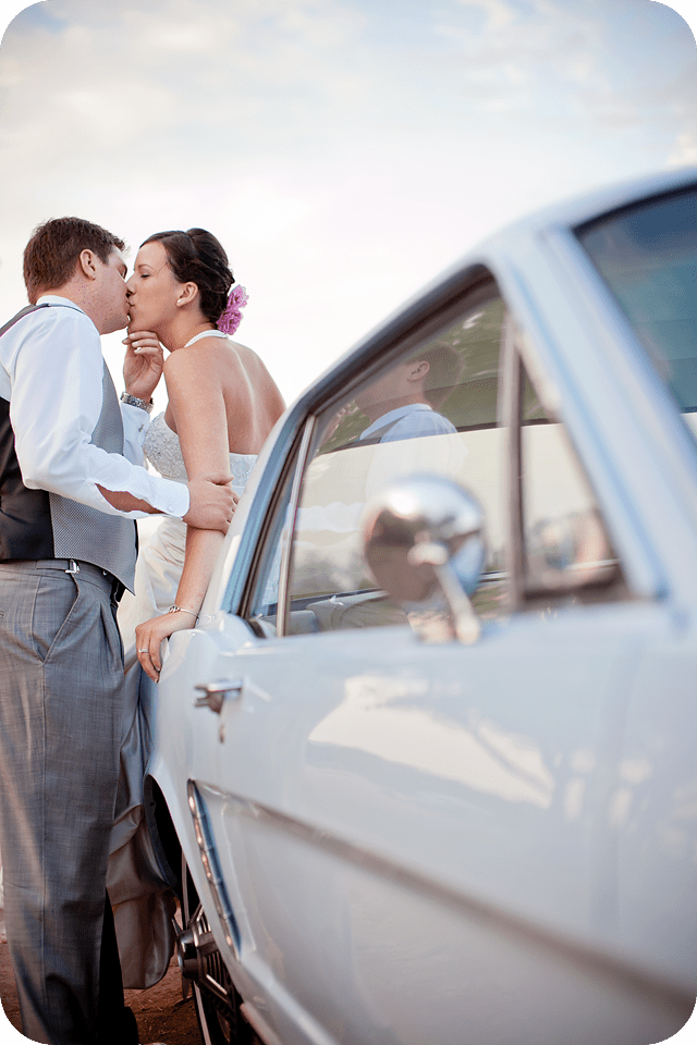 wedding couple with vintage mustang