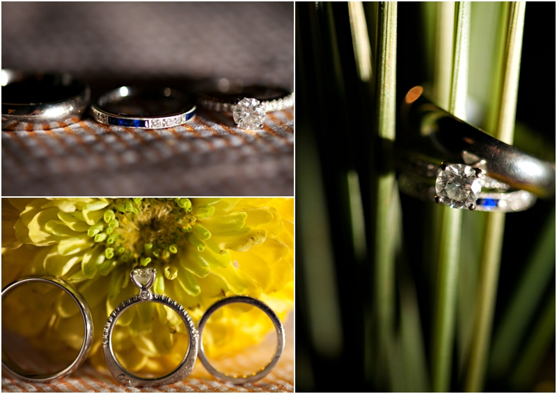 Beautiful wedding rings photographed with centerpieces, grass, and flowers. Sapphire and diamond wedding band detail shot