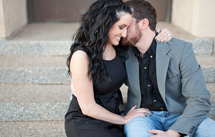 lubbock couple's engagement photos in black dress and heels, and grey suit jacket and jeans