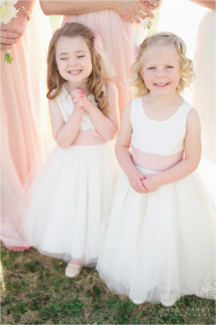 adorable flower girls in blush sashes