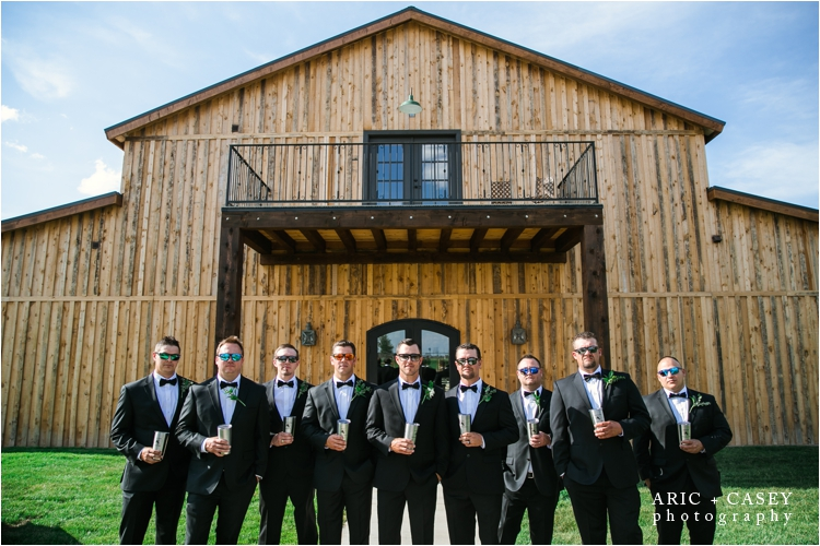 groomsmen in front of eberly brooks event center