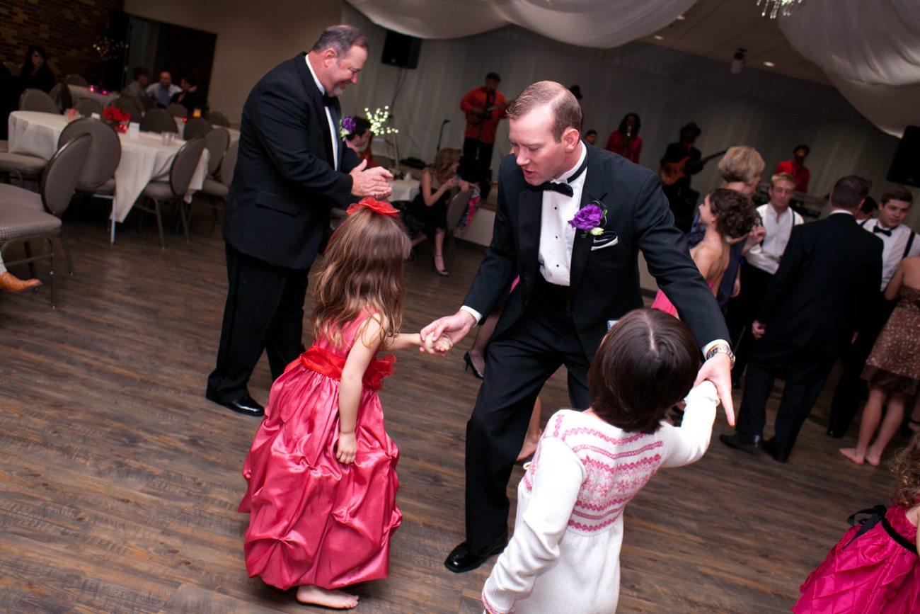 groomsmen dancing with cousins